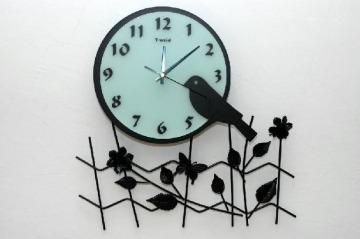 Kovácsoltvas óra
